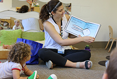 Campers Enjoy Story Time with Mid-County Branch Librarian